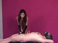 latina mistress in high boots plus gloves uses suction on slave