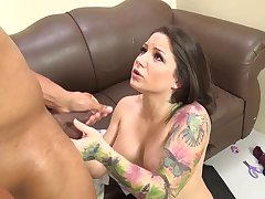 Tattooed milf with big tits gets their way face fucked with a big black cock