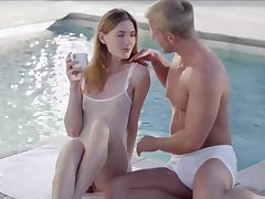 Fresh babe and a wealthy, handsome chap are explosion sporadically have sex, by the swimming pool