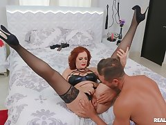 Redhead busty model Andi James gets fucked balls deep on the wainscotting
