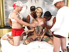 Crowd of chunky sulky guys fuck anal hole of tattooed tranny Gaby Ink