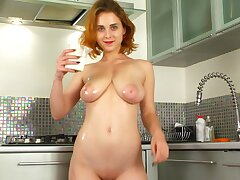 Lord it over solo redhead Eva Blade pleasures her pussy in the cookhouse