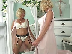 Blond cougar in sexy lingerie Molly Maracas admires himself and masturbates