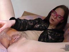 College nerd fucks her wet pussy with a toy