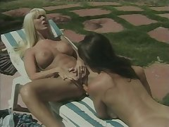 Hot lesbians have dildo fun by the pool